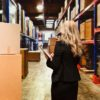Rear view of businesswoman in warehousehttp://www.twodozendesign.info/i/1.png